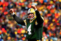 Green Bay Packers quarterback Brett Favre celebrates after throwing a touchdown pass in the NFC Divisional Playoff game against the 49ers on January 4, 1997. The Packers won 35-14.