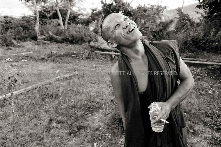 11/25/2006--Phnom Penh, Cambodia..Cobra, Hong Thiv, now a Buddhist monk in a temple about 3 hrs from Phnom Penh. Cobra lost his arm in 2005 after a real cobra bite his arm...Photograph By Stuart Isett.All photographs ©2006 Stuart Isett.All rights reserved.