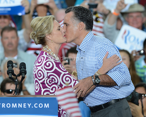 PORT ST. LUCIE, FL - OCTOBER 07: Republican presidential candidate, former Massachusetts Gov. Mitt Romney and his wife Ann Romney kiss during a rally at Tradition Town Square on October 7, 2012 in Port St. Lucie, Florida. © mpi04/MediaPunch Inc.