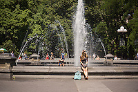 Sweltering New Yorkers and visitors gravitate towards parks with fountains, such as Washington Square Park in Greenwich Village in New York on Wednesday, June 18, 2014. Temperatures are expected to reach or come close to 90 degrees Fahrenheit (30 celsius) making it potentially the hottest day since September.  ( © Richard B. Levine)