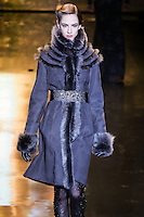 Maria Kashleva walks runway in an anthracite shearling coat, from the Badgley Mischka Fall 2011 fashion show, during Mercedes-Benz Fashion Week Fall 2011.