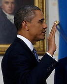 United States President Barack Obama takes the oath of office in front of a portrait of President James Madison in the Blue Room of the White House in Washington, January 20, 2013. .Credit: Larry Downing / Pool via CNP