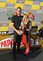 Feb 26, 2017; Chandler, AZ, USA; NHRA top fuel driver Leah Pritchett celebrates with husband Gary Pritchett after winning the Arizona Nationals at Wild Horse Pass Motorsports Park. Mandatory Credit: Mark J. Rebilas-USA TODAY Sports