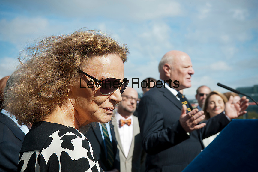Major donor Diane von Furstenberg listens as her husband Barry Diller, CEO of IAC/Interactive, speaks at the groundbreaking ceremony for the third segment of the High Line Park, covering West 30th to West 34th Streets in New York, on Thursday, September 20, 2012.The final phase of the popular park is scheduled to open in 2014 and over ten million visitors have toured the park since its opening in 2009.   (© Richard B. Levine)