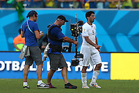 A television camera follows Luis Suarez of Uruguay as he leaves the field at full time