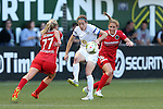 19 June 2015: Kansas City's Liz Bogus (center) is defended by Portland's McCall Zerboni (77) and Rachel Van Hollebeke (16). The Portland Thorns FC hosted FC Kansas City at Providence Park in Portland, Oregon in a National Women's Soccer League 2015 regular season match. The game ended in a 1-1 tie.
