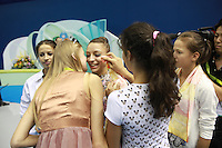 September 11, 2009; Mie, Japan;  (Center) Evgeniya Kanaeva of Russia has just become world champion in the individual All Around and is congratulated by Russian team members with (Left) Olga Kapranova (2005 world champion) to Evgeniya's immediate left.  Scene from the 2009 World Championships Mie, Japan. This image was on 'daypic' page some days after the world championships.  Zhenya had just won individual AA and Olga gives kiss while friends clear off tears of happiness.Photo by Tom Theobald.