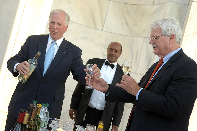 Rep. Mike Thompson, D-Calif., serves a glass of wine to Rep. George Miller, D-Calif., at a wine and cheese reception hosted by the Congressional Wine Caucus and Congressional Organic Caucus held to sample wines and products farmed by organic and sustainable methods. .