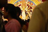 INDIA (West Bengal - Calcutta)  2006, Crowd of pandal hoppers at Madox Square Pandal on the occassion of Durga Puja Festival. It is a hot spot for young crowds in South Calcutta . Durga Puja Festival is the biggest festival among bengalies.  As Calcutta is the capital of West Bengal and cultural hub of  the bengali community Durga puja is held with the maximum pomp and vigour. Ritualistic worship, food, drink, new clothes, visiting friends and relatives places and merryment is a part of it. In this festival the hindus worship a ten handed godess riding on a lion armed wth all possible deadly ancient weapons along with her 4 children (Ganesha - God for sucess, Saraswati - Goddess for arts and education, Laxmi - Goddess of wealth and prosperity, Kartikeya - The god of manly hood and beauty). Durga is symbolised as the women power in Indian Mythology.  In Calcutta people from all the religions enjoy these four days of festival in the moth of October. Now the religious festival has become the biggest cultural extravagenza of Calcutta the cultural capital of India. Artistry and craftsmanship can be seen in different sizes and shapes in form of the idol, the interior decor and as well as the pandals erected on the streets, roads and  parks.- Arindam Mukherjee