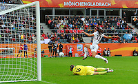 Alex Morgan of team USA and goalkeeper Berangere Sapowicz of team France during the FIFA Women's World Cup at the FIFA Stadium in Moenchengladbach, Germany on July 13th, 2011.