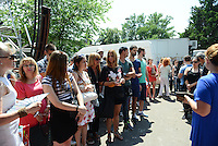 "Members of the studio audience wait to enter the studio for a taping of ""Zvezde Granda,"" or ""Grand Stars,"" a premier turbofolk showcase on Serbian television, in Belgrade, Serbia on July 1, 2015.  Members of the studio audience are paid 500 dinars, approximately $5, a day for their role and participation in the tapings which last for hours."