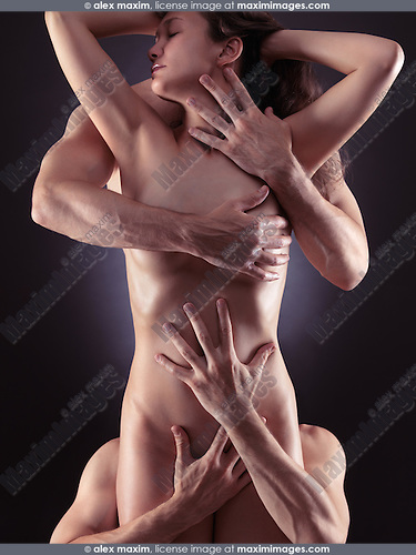 Artistic sensual photo of a beautiful naked woman and four male hands embracing her body