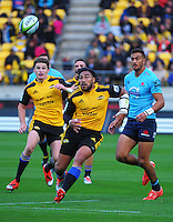 Ma'a Nonu chases his chip kick with Beauden Barrett (left) in support during the Super Rugby match between the Hurricanes and Waratahs at Westpac Stadium, Wellington, New Zealand on Saturday, 18 April 2015. Photo: Dave Lintott / lintottphoto.co.nz