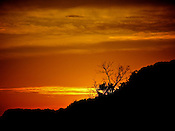 Photo of sunset by Leandra Lewis along the Illinois River bluffs in Grafton, Illinois