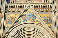 Close up of a gable with mosaics depicting the the Virgin Mary created between 1350 and 1390 after designs by artist Cesare Nebbia on the14th century Tuscan Gothic style facade of the Cathedral of Orvieto, designed by Maitani, Umbria, Italy