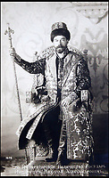BNPS.co.uk (01202 558833)<br /> Pic: HAldridge/BNPS<br /> <br /> Tsar Nicholas III in ceremonial robes, 1913.<br /> <br /> Poignant photographs of the last Russian royal family visiting their British relatives - the King and Queen of Britain - have come to light.<br /> <br /> The black and white images show Tsar Nicholas II, his wife Alexander and their children at Osborne House on the Isle of Wight in 1909 with Edward VII and his wife, Mary of Teck.<br /> <br /> The images show just how close the two Royal families were. <br /> <br /> The album of up to 100 photo postcards is being sold for &pound;1,500 by Henry Aldridge and Son.