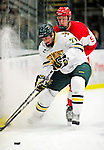 9 January 2011: University of Vermont Catamount defenseman Anders Franzon (27), a Sophomore from Plattsburgh, NY, battles forward Alex Chiasson (9), a Sophomore from St. Augustin, Quebec during a game against the Boston University Terriers at Gutterson Fieldhouse in Burlington, Vermont. The Catamounts fell to the Terriers 4-2 in Hockey East play. Mandatory Credit: Ed Wolfstein Photo