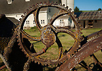 Rusty old wheels forming a fence around the farm buildings