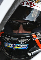 21 June 2009:  Patrick Dempsey sits in his race car before the EMCO Gears Road Racing Classic at Mid-Ohio Spotts Car Course ini Lexington, OH.