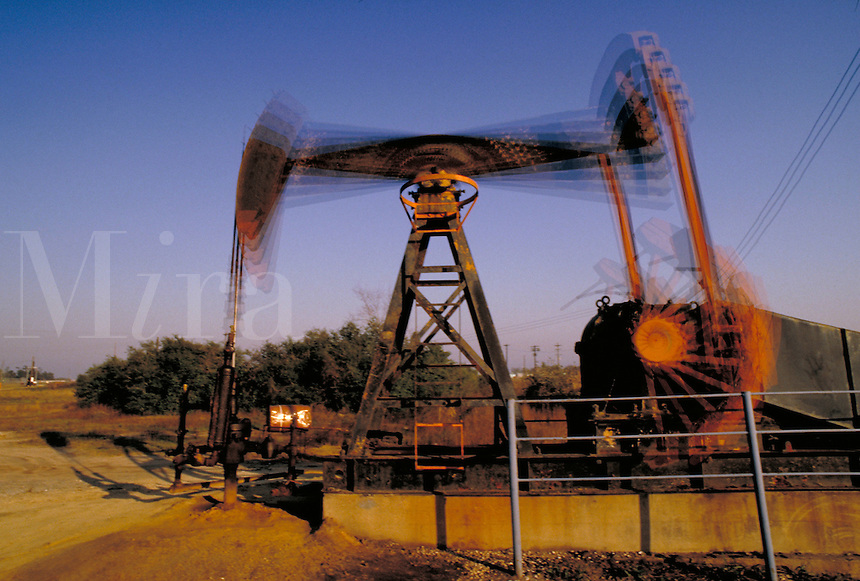 Petroleum industry ; oil ; production ; pumpjack ; domestic ; motion ;. Houston Texas.