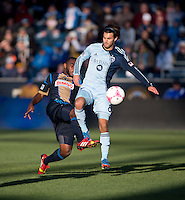 Graham Zusi (8) of Sporting Kansas City collides with Amobi Okugo (14) of the Philadelphia Union during a Major League Soccer game at PPL Park in Chester, PA. Sporting Kansas City defeated the Philadelphia Union, 2-1.