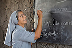 Sister Ninet D'Costa, FMA, a Catholic nun from India, is a teacher trainer in Malakal, Southern Sudan. Sister D'Costa came to the war-torn African country under the auspices of Solidarity with Southern Sudan, an international network of Catholic groups supporting Southern Sudan with educational personnel and prayer. Here Sister D'Costa supervises a teacher's work in a classroom in Detang, a small village across the Upper Nile River from Malakal.