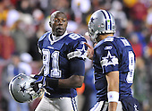 Landover, MD - November 16, 2008 -- Dallas Cowboys wide receiver Terrell Owens (81) looks at quarterback Tony Romo (9) as the latter gives him instructions late in the fourth quarter against the Washington Redskins at FedEx Field in Landover, Maryland on Sunday, November 16, 2008.  Dallas won the game 14 - 10..Credit: Ron Sachs / CNP