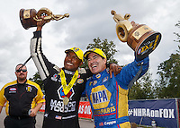 Aug 20, 2016; Brainerd, MN, USA; NHRA top fuel driver Antron Brown (left) and funny car driver Ron Capps celebrate after winning the Protect the Harvest Nationals from Seattle, WA that was delayed by rain to run during qualifying for the Lucas Oil Nationals at Brainerd International Raceway. Mandatory Credit: Mark J. Rebilas-USA TODAY Sports