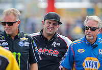 Sep 18, 2016; Concord, NC, USA; Bobby Lagana (center) crew member for NHRA top fuel driver Steve Torrence during the Carolina Nationals at zMax Dragway. Mandatory Credit: Mark J. Rebilas-USA TODAY Sports