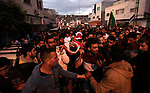 Palestinian mourners carry the body of Ahmad Kamil, a Palestinian man who was shot dead by Israeli security forces after he tried to stab a member of the Israeli security forces at the Al-Jalama checkpoint between the northern West Bank and Israel, during his funeral in the village of Qabatiya, near the West Bank town of Jenin on October 30, 2015. Photo by Nedal Eshtayah