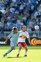 Graham Zusi (8) Sporting KC midfielder challenges Red Bulls midfielder Teemu Tainio for the ball... Sporting Kansas City defeated New York Red Bulls 2-1 at LIVESTRONG Sporting Park, Kansas City, Kansas.