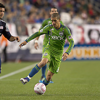 Seattle Sounders midfielder Osvaldo Alonso (6) dribbles down the wing. In a Major League Soccer (MLS) match, the Seattle Sounders FC defeated the New England Revolution, 2-1, at Gillette Stadium on October 1, 2011.