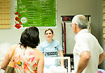 Waterbury, CT- 18 May 2017-051817CM07- Julinda Kulla, center, chats with Miranda and Zenel Hoxha of Bristol  during the an Albanian Festival at the Albanian American Muslim Community center.  The event continues Friday from 5p.m. until 11p.m. and Saturday from 12 p.m. until 11 p.m.  Christopher Massa Republican-American
