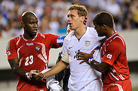 Jimmy Conrad (12) of the United States (USA) is helped off the field by Felipe Baloy (23) and Luis Moreno (3) of Panama (PAN) after being injured on a play. The United States (USA) defeated Panama (PAN) 2-1 during a quarterfinal match of the CONCACAF Gold Cup at Lincoln Financial Field in Philadelphia, PA, on July 18, 2009.