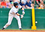 24 July 2010: Vermont Lake Monsters infielder Jason Martinson attempts a bunt against the Lowell Spinners at Centennial Field in Burlington, Vermont. The Spinners defeated the Lake Monsters 11-5 in NY Penn League action. Mandatory Credit: Ed Wolfstein Photo