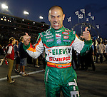 3-29-08 AL DIAZ / MIAMI HERALD -- IndyCar Series Gainsco Auto Insurance Indy 300 at Homestead-Miami Speedway. Driving for the 7-Eleven team is Tony Kanaan of Brazil. Here, Kanaan gives a thumbs up and a growl as he walks to his racecar before the start of the race. Kanaan, lives on Key Biscayne.