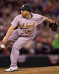 Oakland Athletics starter Bartolo Colon follows through on a pitch against Seattle Mariners Michael Saunders in the eight inning at SAFECO Field in Seattle April 13, 2012.  Colon held the Mariners to four hits in the Athletics 4-0 win over the Mariners.  © 2012. Jim Bryant Photo. All Rights Reserved.  .