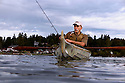 WA09970-00...WASHINGTON - Phil Russell fishing in Lake Stevens. (MR# R8)