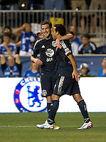 Chris Pontius (13) celebrates his goal with teammate Dwayne De Rosario (7) of the MLS All-Stars  during the game at PPL Park in Chester, PA.  The MLS All-Stars defeated Chelsea, 3-2.