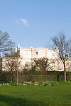 Londoners lay on the lawn, enjoying spring in Regent's Park, London, England