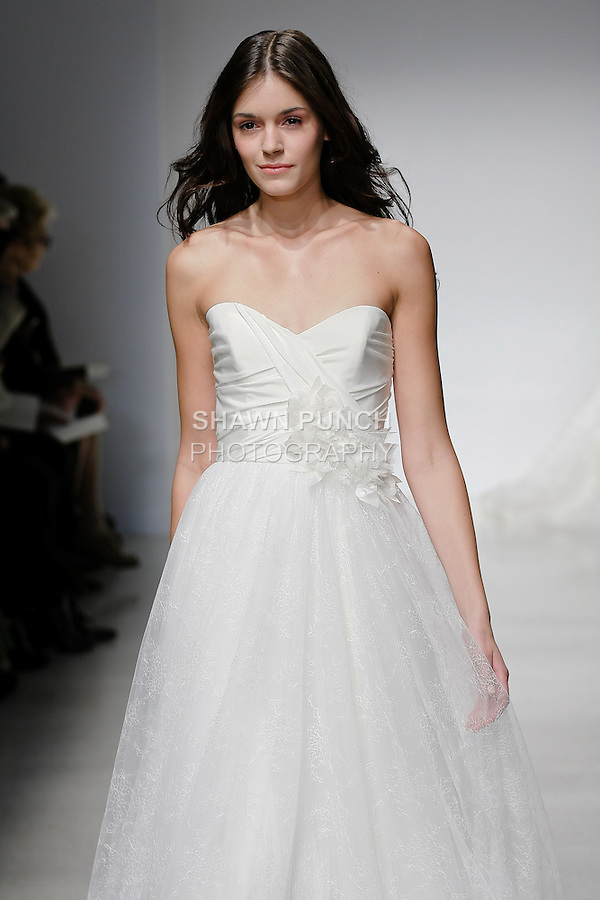 Model walks runway in a Caryis wedding dress by Amsale Aberra, for the Christos Spring 2012 Bridal runway show.