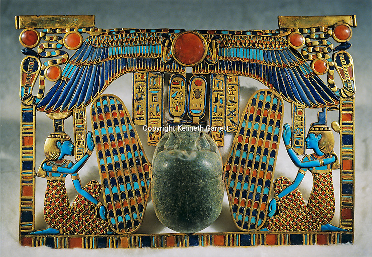 Inlaid pectoral, Winged scarab with goddesses Isis and Nephthys, Tutankhamun and the Golden Age of the Pharaohs, Page 257