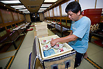 "Staffer Kaiichiro Fujita readies food and drink for an evening of entertainment aboard a ""Yakata-bune"" pleasure boat run by the Yasuda family in Tokyo, Japan on 31 August  2010. .Photographer: Robert Gilhooly"