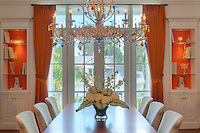 The Murano glass chandelier from Italy was custom designed by Sharon Gilkey for this dining room