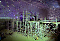 A construction worker walks inside the Water Cube in Beijing, which is getting ready to host the 2008 Olympic Games. The Water Cube is where the swimming events will take place..