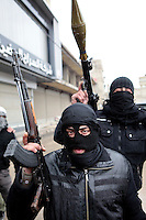 Two disguised members of the Free Syrian Army, an armed group that has risen up against the regime of President Bashar al-Assad, holding an AK47 and a rocket propelled gun (RPG) in the Sakba district of Damascus. The Free Syrian Army claims to be predominately made up of deserters from the regular army who objected to being called on to shoot protesting civilians.