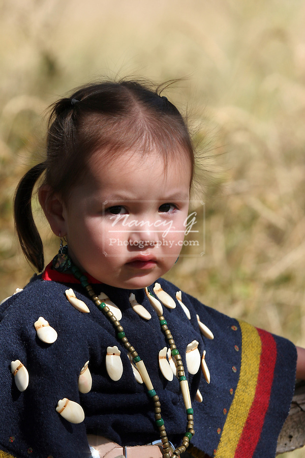 Young Native American Girl on the South Dakota Reservation dressed up in traditional clothes