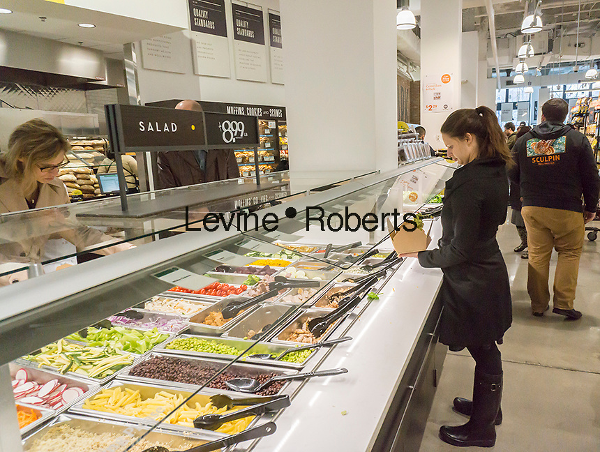 Shoppers at the salad bar in the new Whole Foods Market in Newark, NJ on opening day Wednesday, March 1, 2017. The store is the chain's 17th store to open in New Jersey. The 29,000 square foot store located in the redeveloped former Hahne & Co. department store building is seen as a harbinger of the revitalization of Newark which never fully recovered from the riots in the 1960's.  (© Richard B. Levine)