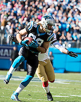 The Carolina Panthers played the San Francisco 49ers at Bank of America Stadium in Charlotte, NC in the NFC divisional playoffs on January 12, 2014.  The 49ers won 23-10.  Carolina Panthers tight end Greg Olsen (88)
