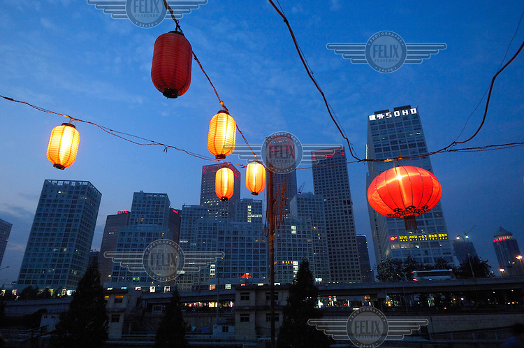 View of Central Business District Chaoyang skyscrapers, including Jianwai SOHO, with lanterns for a restaurant in the foreground.